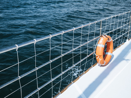 Boat yacht and life ring at sea Foto de archivo