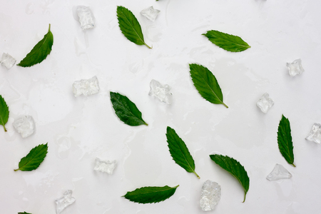 fresh mint leaves and ice background.