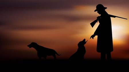 Hunter met honden in de vroege ochtend