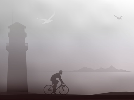 bicycling: Cyclist rides along the coast in foggy weather