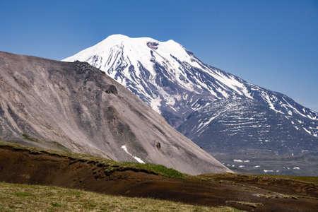 Picturesque summer volcanic landscape of Kamchatka Peninsula: view of active Volcano. Eurasia, Russia, Far East, Kurile lake, South Kamchatka Sanctuary Standard-Bild - 130773305