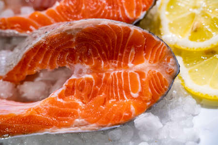 Salmon with lemon and pepper. Standard-Bild - 130773362