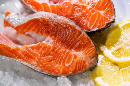 Salmon with lemon and pepper. Standard-Bild - 130773364