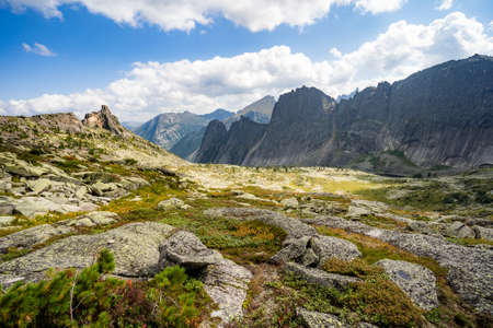 Gorgeous view on top of western Sayan mountain range during summer sunny day in Ergaki national park, Siberia, Russia/