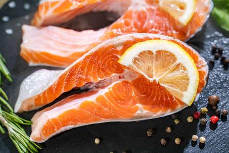 lightly smoked irish salmon fillet with salt and pepper. Standard-Bild - 130773728