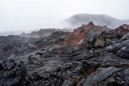 The active lava flow from a new crater on the slopes of volcanoes Tolbachik - Kamchatka, Russia. Standard-Bild - 130773813