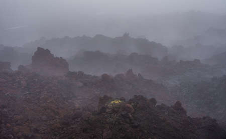 The active lava flow from a new crater on the slopes of volcanoes Tolbachik - Kamchatka, Russia. Standard-Bild - 130773820
