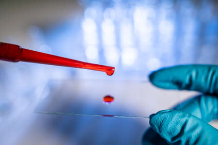 drop of blood on a glass slide using micropipette microtip Imagens