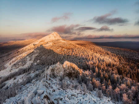 Majestic landscape glowing by sunlight in the morning. Dramatic and picturesque wintry scene. Southern ural mountains, taganay national park Imagens