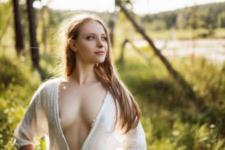 Portrait of beautiful girl in field Фото со стока