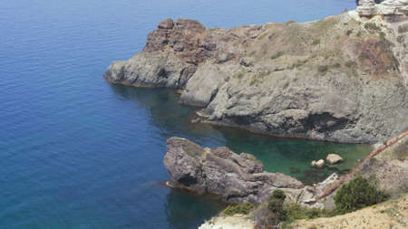 Aerial shooting of a beautiful fox bay in Crimea. Amazing aerial shot of rock formation in Crimea. Flight over rocks and sea. Zdjęcie Seryjne