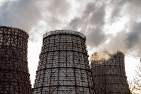 Power plant emits thick smoke. Concept - environmental pollution, global warming Imagens