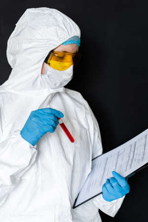 Woman working with blood sample in laboratory.
