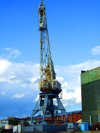 nautical structure: Photo of the big tower crane on shipyard. Stock Photo