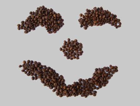 The ridiculous face laid out from coffee grains. photo