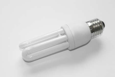 volts: Photo of an electric bulb on a white background. Stock Photo