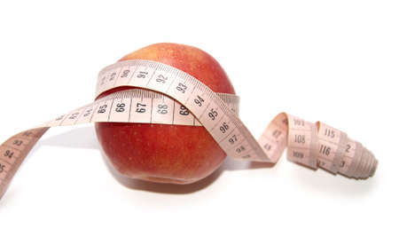 kilograms: Photo of a red apple on a white background wound in the centimeter. Stock Photo