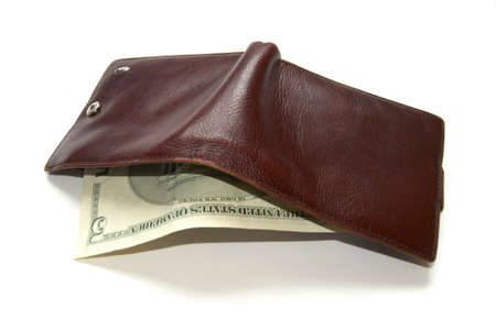 overfilled: Photo of a full purse with dollars on a white background. Stock Photo