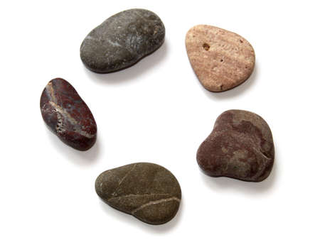 Close-up colored stones for spa procedures on a white.