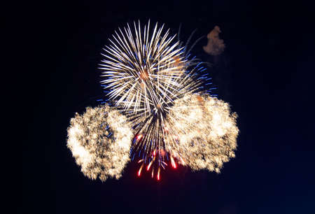 finale: Splashes in colourful fireworks in the night sky. Stock Photo