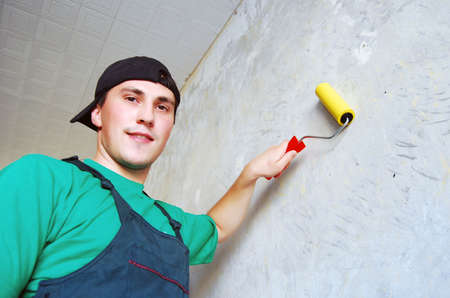 Young man in a builder uniform. Stock Photo - 5885844
