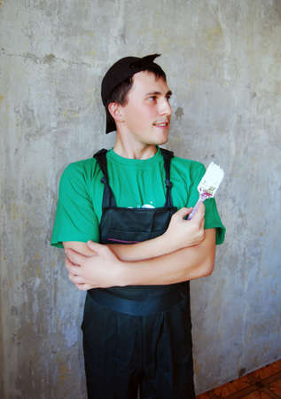 Muscular young man in a builder uniform. Stock Photo - 6182508