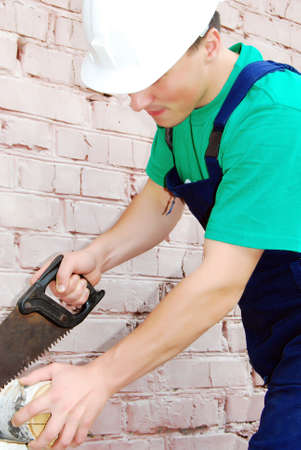 Muscular young man in a builder uniform. Stock Photo - 6174624