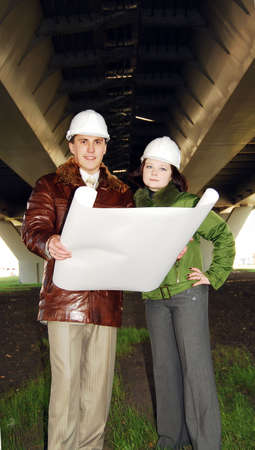 Young architects wearing a protective helmet standing. Stock Photo - 8040836