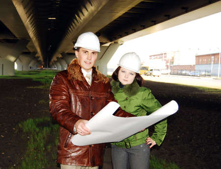 Young architects wearing a protective helmet standing. Stock Photo - 6195312