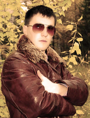 Portrait of attractive young guy in winter leather jacket.