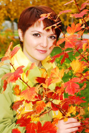Young pretty woman in the autumn park. photo