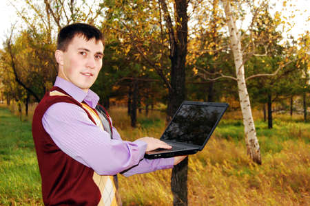 Man with laptop outdoor. photo