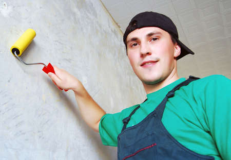 Muscular young man in a builder uniform. Stock Photo - 7986133
