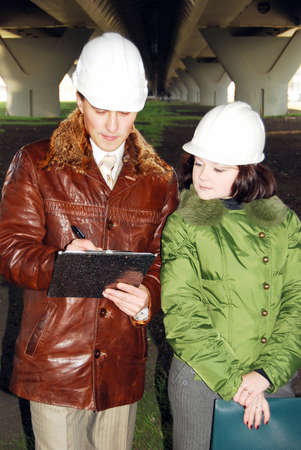 Young architects looking at blueprint. Stock Photo - 8054327
