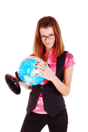 The beautiful girl, the teacher of geography with the globe. photo