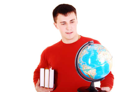 Young man look at globe. photo