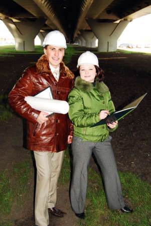 Young architects looking at blueprint. Stock Photo - 8030312
