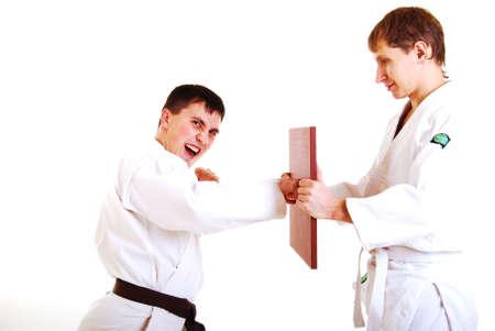 Two karatekas on a white background. photo