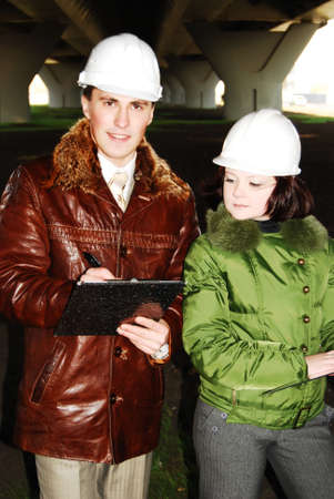 Young architects wearing a protective helmet standing. Stock Photo - 8239749