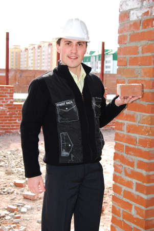 Bricklayer with brick. Stock Photo - 9642321