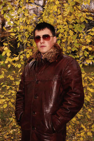 Portrait of attractive young guy in winter leather jacket.  photo