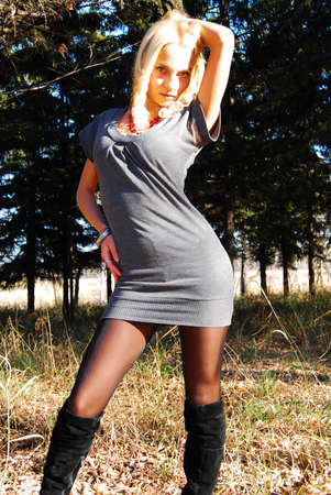 The sexy girl in autumn wood. Stock Photo - 11108525