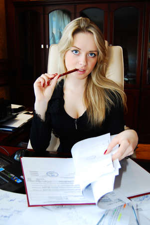Beautiful business woman, working in the office. photo