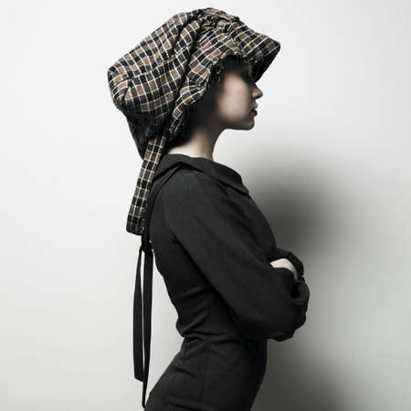 Fashion portrait of young lady with hat Stock Photo - 4316877