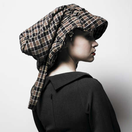 Fashion portrait of young lady with hat Stock Photo - 4316883