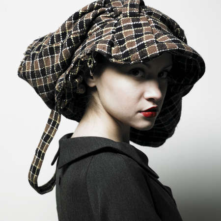 Fashion portrait of young lady with hat Stock Photo - 4316890