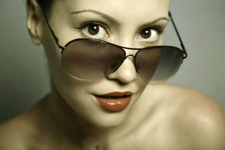 Fashion portrait of young pretty woman with glasses photo