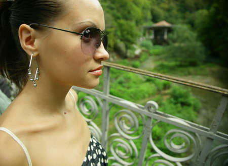 Portrait of young pretty woman with glasses photo