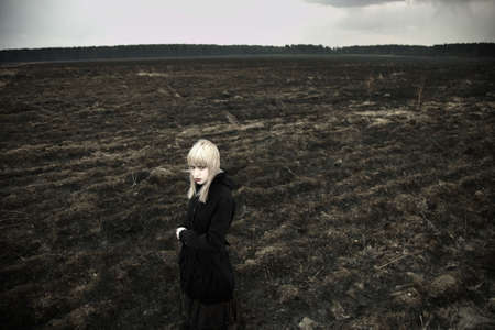 Fine art portrait of elegant girl on black field. photo