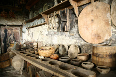 antiquarian: Ancient interior. Beautiful antiquarian tableware in old kitchen.
